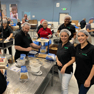 Cash 1 volunteered packing food for Feed My Starving Children.